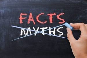Facts and myths written on a chalk board - myths crossed out