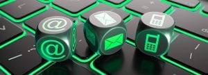 Contact us | dice on a keyboard featuring dice with an @, mail logo, and cell phone logo