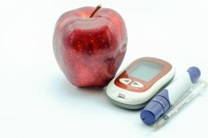 apple and diabetic insulin syringe for blood sugar
